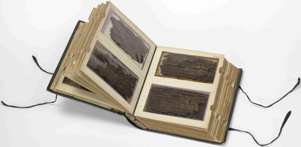 The 70 leaves of birch bark that make up the Bakhshali manuscript are incredibly fragile and are housed in this specially designed book at the Bodleian Libraries' Weston Library, Oxford. Scholars are able to view both sides of the birch bark through the 'windows' of the book. Bodleian Libraries, University of Oxford